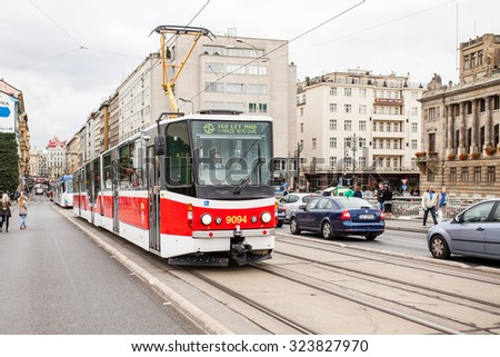 PRAGUE, CZECH REPUBLIC - SEPTEMBER 20, 2015: The vintage excursion tram parade goes on the central city street in Prague. 140 years of public transport.