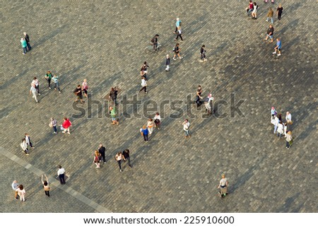PRAGUE, CZECH REPUBLIC - SEPTEMBER 9, 2014: Tourists at Prague Old Town square walking in different directions - stock photo