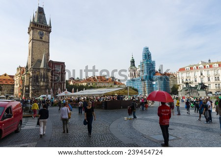 PRAGUE, CZECH REPUBLIC - SEPTEMBER 18, 2014: Tourists on Old Town Square. Old Town Square is a historic square in the Old Town quarter of Prague. - stock photo