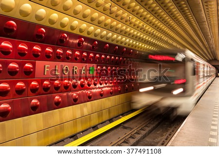 PRAGUE, CZECH REPUBLIC - SEPTEMBER 23, 2015: Train arrives at station in Prague metro - 65.2 kilometers long, founded in 1974, has 3 lines and 61 stations. Its is fifth busiest metro system in Europe. - stock photo
