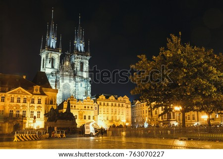 Prague, Czech Republic, September 30, 2017: Unrecognizable tourists walking on  Old Town Hall at night in Prague