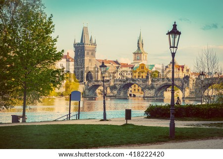 Prague, Czech Republic skyline with historic Charles Bridge and Vltava river as seen from spring park. Vintage - stock photo