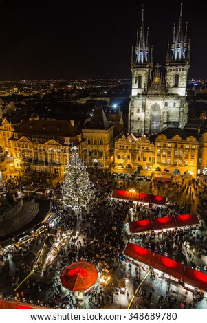 PRAGUE, CZECH REPUBLIC - 6TH DECEMBER 2015: A high view of the Christmas Market in Prague showing Church of Our Lady before Tyn, the market stalls, people and the tree. - stock photo