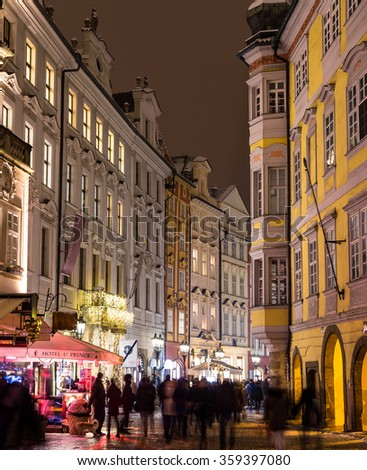 PRAGUE, CZECH REPUBLIC - 6TH JANUARY 2016: A view down Male Namesti street in prague at night. Large amounts of people can be seen.