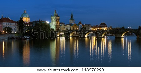 Prague, Evening panorama of the Charles Bridge with Old Town bridge tower and Dome of the church of Saint Francis of Assisi, Czech Republic