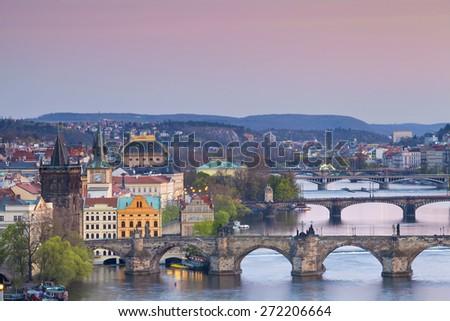 Prague. Image of Prague, capital city of Czech Republic with Charles Bridge and many other bridges crossing Vltava River. - stock photo