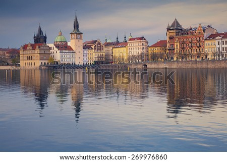 Prague. Image of Prague riverside with reflection of the city in Vltava River. - stock photo