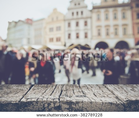 Prague in Czech Republic with Blurred Tourists with Instagram Style Filter - stock photo