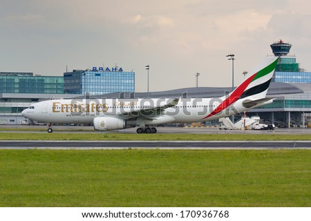 PRAGUE - JULY 10:A330 Emirates taxis for take off from  PRG in Prague, CZE on July 10, 2010.  Emirates is rated as a top 10 best airlines in the world flying on youngest fleet. - stock photo