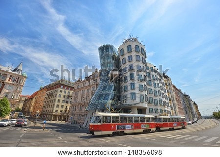 PRAGUE - JULY 24: view of the Dancing House, designed by Vlado Milunic and Frank Gehry on July 24, 2013 in Prague. The building has become an important tourist site since it's completion in 1996.  - stock photo