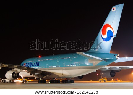 PRAGUE - MARCH 14: A380 Korean Air taxi after landing to terminal PRG in Prague, CZE on March 14, 2014. Blue top livery was introduced on in 1984. Airlines are flag carrier of South Korea - stock photo
