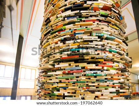PRAGUE - MAY 14: Giant book shelf in the hall of Municipal Library of Prague on May 14 in Czech Republic. Prague's Library comprised of 42 branches, 2 mobile libraries and 344,000 books. - stock photo