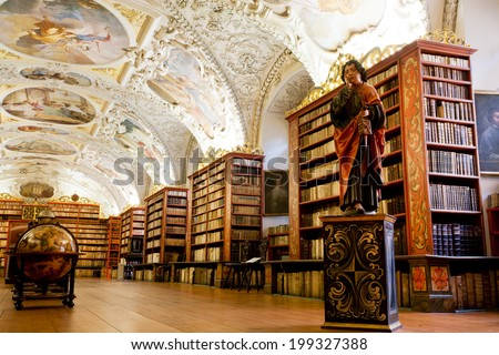 PRAGUE - MAY 17: Plurality of stacks of books in ancient library of Strahov monastery on May 17, 2014 in Czech Republic. Library keeps 200 000 prints, from the period between the 16th & 18th century  - stock photo
