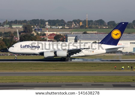 PRAGUE - OCTOBER 02: Lufthansa Airbus A380 airliner lands at PRG Airport on October 02, 2011 in Prague, Czech Republic. The A380 is currently the largest passenger airliner. - stock photo