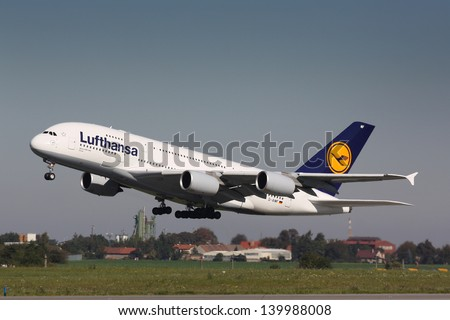 PRAGUE - OCTOBER 02: Lufthansa Airbus A380 airliner takes off on October 02, 2011 in Prague, Czech Republic. The A380 is currently the largest passenger airliner. - stock photo