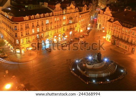 Prague Old Town main square with central monument and old buildings illuminated by night, Czech Republic - stock photo