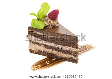 Prague piece of cake decorated with raspberries on a white background - stock photo