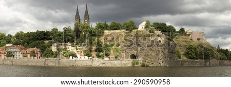 Prague River bank panorama at dramatic lightning just before a storm. - stock photo