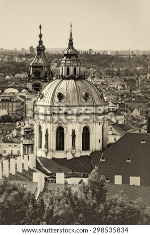 Prague Saint Nicholas Church located on Mala Strana PArt of the Old Town, Sepia Retro Toned Image - stock photo