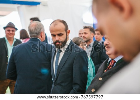 Prague, September 23, 2017: Celebration of the traditional German beer festival Oktoberfest in the Czech Republic. Unknown elegant man with unusual mustaches in a jacket with a tumbler at the event.