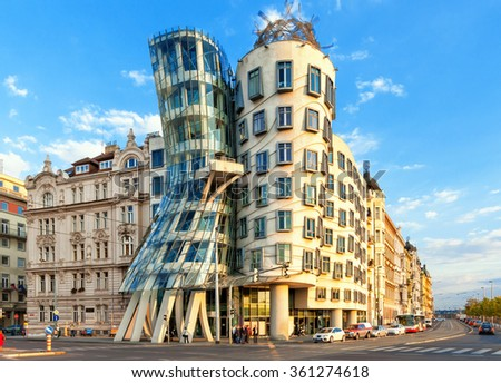 PRAGUE - SEPTEMBER 13, 2014:  Dancing house by Frank Gehry in Prague. Dancing house or Fred and Ginger building in downtown Prague, Czech Republic. - stock photo