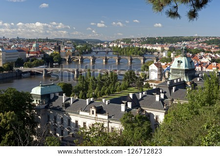 Prague - Skyline with Czech Government Building, Vltava River bridges and Charles Bridge