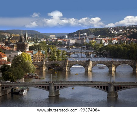Prague - skyline with Vltava River and Charles Bridge - stock photo