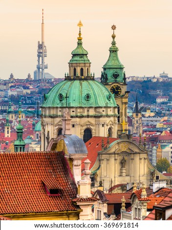 Prague, St. Nicholas Cathedral and Zikzov Television Tower. Czech Republic - stock photo