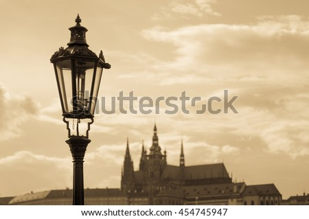 Prague street lamp closeup against Cathedral of Saints Vitus