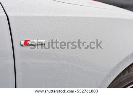 PRAGUE, THE CZECH REPUBLIC, 18.12.2016 - Closeup of new white car Audi Q7 parking in front of car dealership Audi