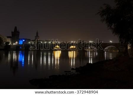 Prague ,view of the Lesser Bridge Tower of Charles Bridge (Karluv Most) at dusk, Czech Republic - stock photo