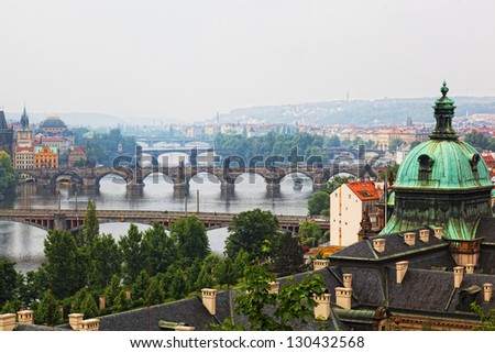 Prague, view of the Vltava River and bridges in a morning fog - stock photo