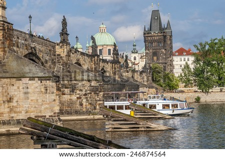 Prague, Vltava River , Charles Bridge , view of the Mala Strana from the right bank . Pleasure boat on the river.