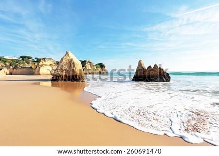 Praia Tres Irmaos in Alvor Portugal - stock photo