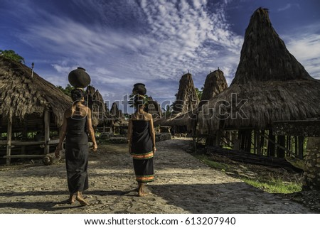 Praing traditional village, West Sumba, NTT, Indonesia - March 24, 2017 : Two women of the traditional village Praing, carrying ceramic water pots on their heads