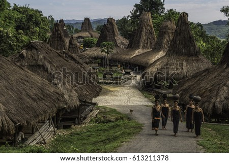 Praing traditional village, West Sumba, NTT, Indonesia - March 24, 2017 : Women from the Praing traditional village with ceramic water pots on their heads walking to the river