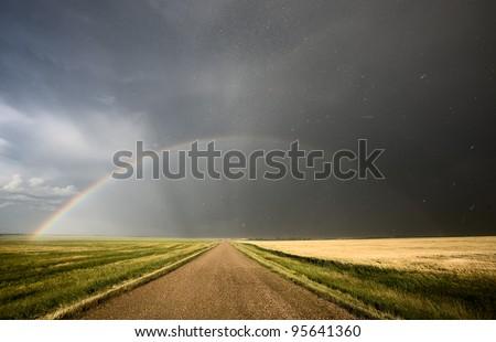 Prairie Hail Storm and Rainbow in Saskatchewan Canada - stock photo