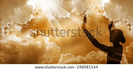 Praise the lord-Woman worshipping god at sunset - stock photo