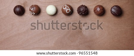 pralines in a row - stock photo