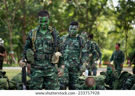 "PRANBURI, PRACHUAP KHIRI KHAN , THAILAND - NOV 24, 2014: Unidentified soldier coming in to waiting area of maneuver in  ""The Ultimate Soldier"" 72 hours battle operation of Thai Royal Army, THAILAND. - stock photo"
