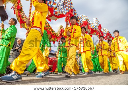 PRATO, ITALY - FEBRUARY 14: Boys in traditional chinese costume during the Chun Jie celebrations, on February 15, 2014 in Prato (Italy)