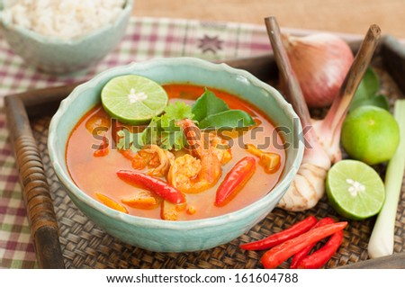 "Prawn and lemon grass soup with mushroom or ""Tom Yum Goong"" is the most famous of all Thai soups, The Tom Yum Goong both spicy sour taste at all sweet. - stock photo"