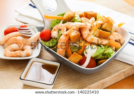 prawn salad with cherry tomato and sippet - stock photo