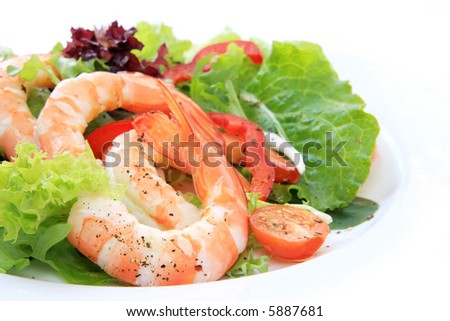 Prawn salad, with mixed greens, tomatoes and peppers, and king-size shrimp. - stock photo
