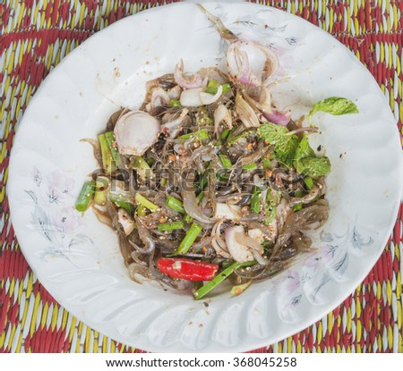 Prawn spicy salad. Simple and healthy  salad of raw shrimp, mixed green , spicy sauce and herbs. - stock photo