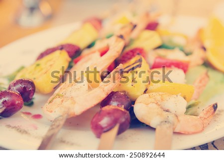 Prawns grilled with fruits - cajun style dish, toned image - stock photo