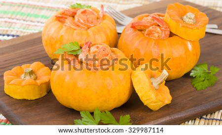Prawns in Pumpkin (Camarao na Moranga) - Prawns with a creamy coconut milk sauce served inside a roasted pumpkin.