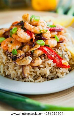prawns, king prawns, prawn, brown rice, rice, vegetables, red, pepper, onion, wooden plate, chives, spring onions, lemon, macro, nobody, restaurant, menu, seafood, fried - stock photo