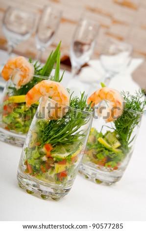 Prawns served in glasses - stock photo