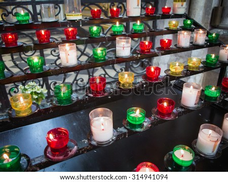Pray candles in church - stock photo